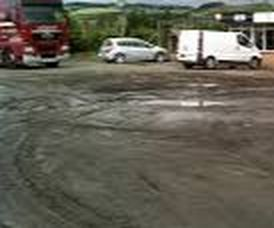 Muddy Parking Lot Discourages Clients  Charlotte NC Paving