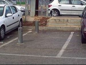 Poles Embedded in Parking Slot- What For?